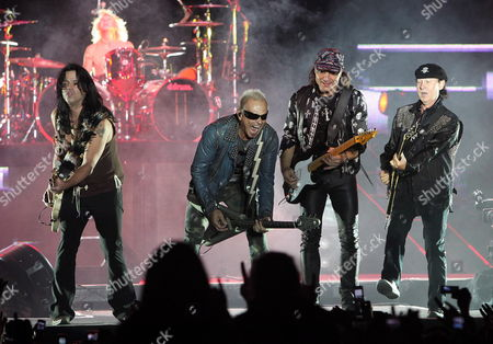 From Left to Right Pawel Maciwoda James Kottak Rudolf Schenker Matthias Jabs and Singer Klaus Meine of German Band Scorpions Perform During Their First and Last Concert in La Paz Bolivia on 16 September 2010 More Than 25 000 People Gathered at the Hernando Siles Stadium where the Group Presented Their Biggest Hits in Their Goodbye Tour Bolivia La Paz