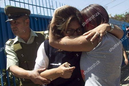 Inmate Relatives Cry After Been Informed About the Tragedy in San Miguel Prison After a Riot and Subsequent Fire Which Killed at Least 83 Inmates at San Miguel Prison in Santiago Chile 08 December 2010 According to Chilean President Sebastian Pinera Hundreds of Inmates Were Evacuated with 14 Prisoners Said to Have Life-threatening Injuries Reports Said the Fire Broke out After a Fight Between Rival Gangs who Set Mattresses on Fire Health Minister Jaime Manalich Said This was the Deadliest Incident in the History of the Chilean Prison Service Chile Santiago