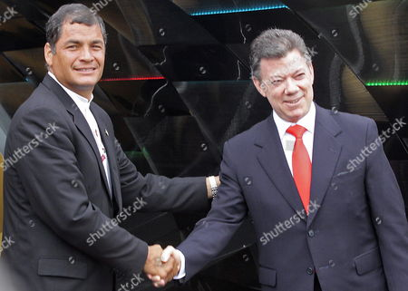 Colombian President Juan Manuel Santos (r) Shakes Hands with His Ecuadorean Counterpart Rafael Correa (l) During Inaugural Event of the 24th Bogota's International Book Fair in Bogota Colombia 05 May 2011 Ecuador is the Honored Guest of the Fair and the Event was Open with a Homage For Recently Passed Away Writer Ernesto Sabato and 2010 Literature Nobel Prize Peruvian Mario Vargas Llosa Colombia Bogota