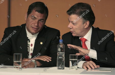 Colombian President Juan Manuel Santos (r) Talks to His Ecuadorean Counterpart Rafael Correa (l) During Inaugural Event of the 24th Bogota's International Book Fair in Bogota Colombia 05 May 2011 Ecuador is the Honored Guest of the Fair and the Event was Open with a Homage For Recently Passed Away Writer Ernesto Sabato and 2010 Literature Nobel Prize Peruvian Mario Vargas Llosa Colombia Bogota