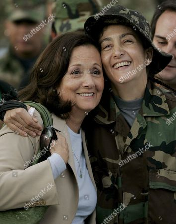 Colombian-french Former Presidencial Candidate Ingrid Betancourt (r) Hugs and Smiles with Her Mother Yolanda Pulecio (l) at Her Arrival to the Militar Airport of Catam in Bogota Colombia on 02 July 2008 After Being Rescued by the Colombian Army in the Jungle of the Eastern Department of Guaviare After a Long Hostage by the Farc Guerrilla Colombia Tolemaida