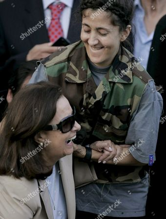 Colombian-french Former Presidencial Candidate Ingrid Betancourt (r) Helps Her Mother Yolanda Pulecio (l) to Stand Up Upon Her Arrival to the Militar Airport of Catam in Bogota Colombia on 02 July 2008 After Being Rescued by the Colombian Army in the Jungle of the Eastern Department of Guaviare After a Long Hostage by the Farc Guerrilla Colombia Bogota
