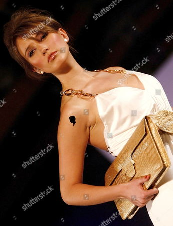 A Picture Dated 04 August 2009 Shows a Model Taking to the Catwalk Wearing a Handbag Designed by Adriana Castro at the International Footwear and Leather Opening Fashion Show in Bogota Colombia Colombia Bogota