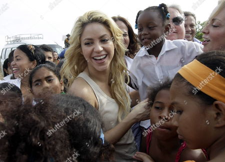 Colombian Singer Shakira (c) is Surrounded by Kids who Will Be Students of School 'Lomas De Peye' in Cartagena Colombia 11 April 2011 the School was Donated by Foundations Pies Descalzos of Shakira and Foundation Howard Buffett and It Will Help the 7 500 Poor Children in This Touristic City Colombia Cartagena