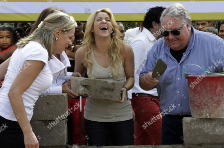 Colombian Singer Shakira (c) Puts a Brick For the Building of New School 'Lomas De Peye' Accompanied by Howard Buffett President of Foundation Howard Buffett (r) and General Secretary of Unasur Maria Emma Mejia (l) in Cartagena Colombia 11 April 2011 the School was Donated by Foundations Pies Descalzos of Shakira and Foundation Howard Buffett and It Will Help the 7 500 Poor Children in This Touristic City Colombia Cartagena