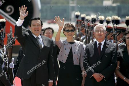 Stock Image of Taiwanese President Ma Ying-jeou (l) His Wife and First Lady Chou Mei-ching (c) and Guatemalan Chancellor Haroldo Rodas (r) Greet the Media at the Guatemalan Air Force Facilities (fag) in Guatemala City on 29 May 2009 at the Arrival of the Leader on a Three Day Visit to the Country to Meet with Guatemala's Counterpart Alvaro Colom to Strength the Friendship Ties Between Both Countries Guatemala Guatemala