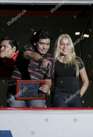 Former Argentinean Soccer Player Diego Armando Maradona (l) Shows a Commemorative Plate with His Girlfriend Veronica Ojeda (r) As He Attends the 14th Leg Mexican League Soccer Match Between Necaxa and Atlante at Victoria Stadium of Aguascalientes Mexico on 12 April 2008 Mexico Aguascalientes