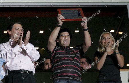 Former Argentinean Soccer Player Diego Armando Maradona (c) Shows a Commemorative Plate with His Girlfriend Veronica Ojeda (r) and the Governor of Aguascalientes Mexican State Luis Armando Reynoso (l) As Maradona Attends the 14th Leg Mexican League Soccer Match Between Necaxa and Atlante at Victoria Stadium of Aguascalientes Mexico on 12 April 2008 Mexico Aguascalientes