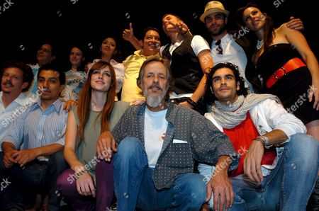Stock Picture of Mexican Theater and Film Director Gabriel Retes (c Down) Poses with the Cast of the Play 'Trainspotting' Based on the Book of British Writer Irvine Welsh Which Will Return to the Theatrical Mexican Stage For Third Time in Mexico City Mexico 14 May 2008 Mexico Mexico City