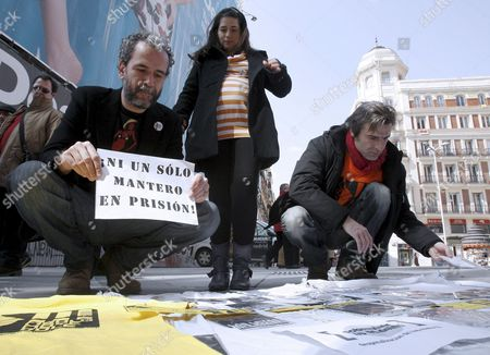 Spanish Actor Willy Toledo (l) Holding a Sign Reading 'Not Even One 'Mantero' in Prison' and Spanish Actor Alberto San Juan (r) Attend a Rally to Support Illegal Cd and Dvd Street Vendors Dubbed 'Manteros' in Spanish in Madrid Spain 13 March 2010 Most 'Manteros' Are Undocumented Immigrants who Cannot Work Legally in Spain the Idea is not to Legalize Street Vending of Pirated Music and Films But to Lessen the Penalties Established by Law to the 'Manteros' who Risk a Two-year Prison Term Spain Madrid