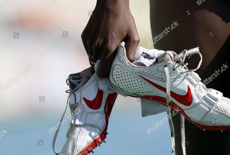 Belgian Athlete Elodie Ouedraogo Holds Her Running Shoes After She Competed in the Second Women's 400 Metres Qualifying Heat of European Athletics Championships at Lluis Companys Olympic Stadium on 27 July 2010 in Barcelona Northeastern Spain Spain Barcelona