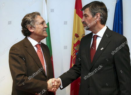 Stock Image of Spain's Junior Minister For the European Union Diego Lopez Garrido (l) Welcomes Bulgarian Deputy Minister of Foreign and European Affairs Konstantin Dimitrov in La Granja Some 90 Kms From Madrid Central Spain on 12 January 2010 Garrido Hosts a Dinner For European Union Officials in La Granja on 12 January Spain La Granja