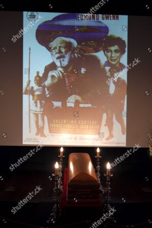 Stock Picture of A Coffin Containing the Remains of Spanish Film Director and Screewriter Luis Garcia Berlanga is on Display in a Funeral Chapel Set Up at the Madrid Film Academy Under a Projected Image of Scenes From His 1952 Film 'íbienvenido Mister Marshall!' (welcome Mr Marshall!) in Madrid Spain on 13 November 2010 Berlanga Honorary President and Co-founder of the Academy Died on 13 November 2010 at His Home in Madrid at the Age of 89 His Most Internationaly Acclaimed Works Included 'Welcome Mr Marshall!' 'The Executioner' and 'Placido' He was Awarded the Prince of Asturias Prize in 1986 Spain Madrid