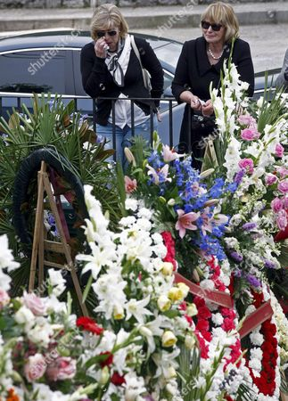 Two Women Cry Next to Some Funeral Wreaths Laying Next to San Pedro Parish After the Small Funeral of Spanish Golfer Severiano Ballesteros Celebrated in His Hometown in Pedrena in the Region of Cantabria Northern Spain 11 May 2011 the 54-year-old Golf Legend Died on 07 May 2011 After a Long Battle Against a Brain Tumour Spain Pedrena