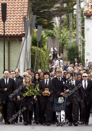 Carmen (2-l) and Javier (c Carrying the Ashes) Children of the Late Severiano Ballesteros Lead the Funeral Procession Celebrated Through the Streets of Severiano's Hometown of Pedrena Accompanied by a Scottish Piper Before the Small Service Held at San Pedro Parish in the Region of Cantabria Northern Spain 11 May 2011 the 54-year-old Golf Legend Died on 07 May 2011 After a Long Battle Against a Brain Tumour Spain Pedrena