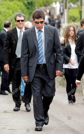 European 2012 Ryder Cup Captain Spanish Golfer Jose Maria Olazabal (c) Leaves San Pedro Parish After the Small Funeral Service Celebrated in Pedrena Hometown of Late Spanish Golfer Severiano Ballesteros in the Region of Cantabria Northern Spain 11 May 2011 the 54-year-old Golf Legend Died on 07 May 2011 After a Long Battle Against a Brain Tumour Spain Pedrena
