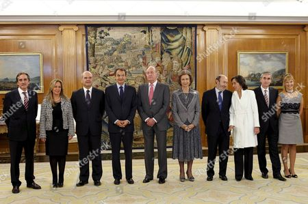Spain's King Juan Carlos (6r) and His Wife Queen Sofia (5-r) and Spain's Prime Minister Jose Luis Rodriguez Zapatero (4-l) Pose with Members of the New Spanish Cabinet (l-r) Labour Minister Valeriano Gomez New Foreign Affairs Minister Trinidad Jimenez Third Deputy Prime Minister Manuel Chavez New First Deputy Prime Minister Alfredo Perez Rubalcaba New Enviroment Agriculture and Fishing Minister Rosa Aguilar New Presidency Minister Ramon Jauregui and New Health Minister Leire Pajin During the Formal Investiture Ceremony (where the Authority of the Office is Conferred) Held at La Zarzuela Palace in Madrid Central Spain 21 October 2010 Jose Luis Rodriguez Zapatero Has Carried out an Extensive Government Reshuffle Spain Madrid