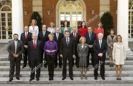 Spanish Prime Minister Jose Luis Rodriguez Zapatero (front Row C) Poses in a Family Photo with His New Cabinet Prior to Their Meeting at La Moncloa Presidential Palace in Madrid Spain 08 April 2009 (front Row L-r) Minister of Justice Francisco Caamano Minister of Territorial Cooperation and Third Deputy Prime Minister Manuel Chaves First Deputy Prime Minister Maria Teresa Fernandez De La Vega Prime Minister Jose Luis Rodriguez Zapatero Minister of Economy and Second Deputy Prime Minister Elena Salgado Foreign Minister Miguel Angel Moratinos and Minister of Defence Carme Chacon (middle Row L-r) Minister of Industry Trade and Tourism Miguel Sebastian Minister of Education Angel Gabilondo Home Minister Alferdo Perez Rubalcaba Minister of Public Works Jose Blanco Minister of Labour and Immigration Celestino Corbacho and Minister of Agriculture Fisheries and Food Elena Espinosa (back Row L-r) Minister of Science and Innovation Cristina Garmendia Minister of Health and Social Policy Trinidad Jimenez Minister of Culture Angeles Gonzalez-sinde Minister of Housing Beatriz Corredor and Minister of Equality Bibiana Aido Zapatero Reshuffled 07 April 2009 His Cabinet and Replaced Several of His Ministers Spain Madrid