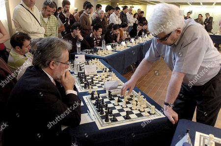 Former Chess World Champion Boris Spassky From Russia Plays with an Amateur During the Simultaneous Chess Match in 'Hay Festival' at Manuel De Falla Auditorium in Granada Southern Spain 03 April 2008 'Hay Festival' is an International Meeting That Joins Musicians Writers and Intellectuals and Will Be Open Until Next 6 April Boris Spassky Won the Chess World Championship in 1969 and Lost It Against Robert James 'Bobby' Fischer in 1972 Spain Granada