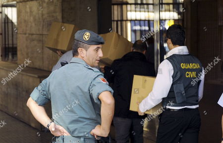 Members of Spain's Civil Guard Leave the Murcia's Urban Development Management Headquarters with the Documents Confiscated Due to an Investigation Against Allegedly Irregularities in Town Planning Procedures in Downtown Murcia South Spain 05 October 2010 Three People Have Been Arrested Including Alberto Guerra Along with a Lawyer Higinio Perez Mateos and an Outside Engineer Renato De Noce According to Murcia's High Court This Case is Related to Different Partial Plans and Re-classifications in Some Areas of the City Spain Murcia