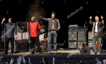 Stock Picture of Us Pianist Chick Corea (r) Bassman Stanley Clarke (2-r) Guitarist Al Di Meola (l) and Drummer Lenny White (2-l) of Us Jazz-rock Band Return to Forever on Stage at the Conde Duque Center of Madrid Spain 10 July 2008 Spain Madrid