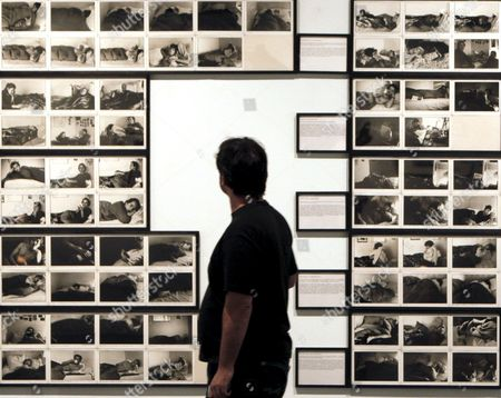 A Man Walks Past a Group of Pictures Displayed in the Exhibition 'Los 70 Fotografia Y Vida Cotidiana' ('the '70s Photography and Daily Life') at the Fundacion Santander in Madrid Spain 02 June 2009 the Exhibition Which is Part of the 'Photoespana 2009' Photography Event is a Compilation of Over 200 Pictures by 23 Photographers Like David Goldblatt Anders Peterson Cindy Sherman Malick Sidibe and Eugene Richards Spain Madrid