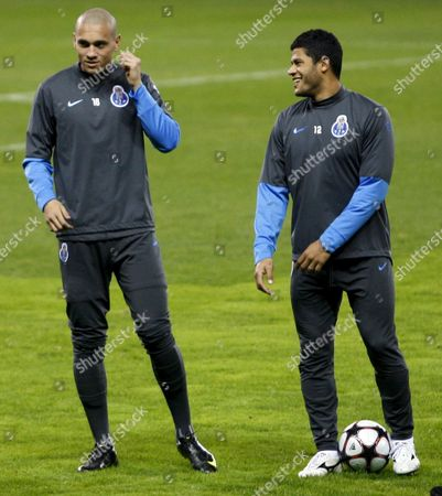 Oporto's Player Givanildo Vieira De Souza 'Hulk' (r) and His Brazilian Team-mate Maicon Pereira Roque Chat During a Training Session at Vicente Calderon Stadium in Madrid Central Spain 07 December 2009 Oporto Will Face Atletico Madrid on 08 December in a Champions League Group Stage Match Spain Madrid