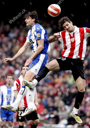 Athletic Bilbao's Defender Aitor Ocio (r) Jumps For the Ball with Midfielder Albert Riera of Rcd Espanyol During Their Spanish First Division League Soccer Match at San Mames Stadium in Bilbao Basque Country Northern Spain 06 April 2008 Spain Bilbao