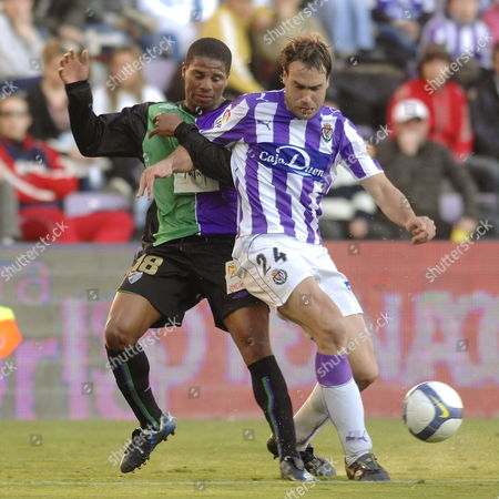 Malaga?s Portuguese Midfielder Eliseu Pereira Dos Santos (l) Fights For the Ball with Real Valladolid?s I±aki Bea (r) During Their Spanish Primera Division Soccer Match Played at the Nuevo Estadio Jos? Zorrilla Stadium in Valladolid 22 February 2009 Spain Valladolid