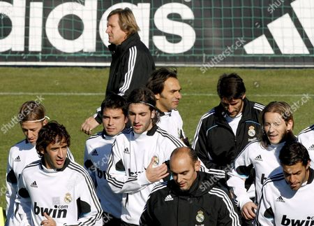 Real Madrid Soccer Team's Coach Geman Bernd Schuster (back- C) and His Players During a Training Session Held at the Valdebebas Sports City in Madrid Central Spain 19 November 2008 the Club's Sporting Director Predrag Mijatovic on 18 November Gave a Vote of Confidence to Bernd Schuster and His Players in the Wake of Saturday's Defeat Double Champions Real Have Suffered Several Recent Defeats in All Competitions and Are Currently Fourth in the Primera Liga Five Points Behind Leaders Barcelona Spain Madrid