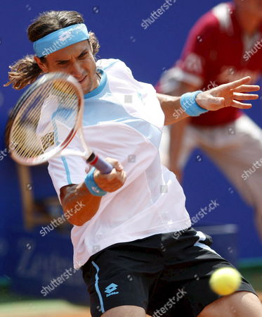 Spanish Tennis Player David Ferrer Hits a Forehand During His Second Round Match Against Compatriot Guillermo Trujillo at the Conde De Godo Tournament in Barcelona Northeastern Spain 30 April 2008 Ferrer Won the Match by 6-1 6-1 Spain Barcelona