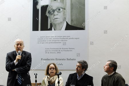 (l-r) Argentinean Economist Bernardo Kliksberg Elvira Gonzalez Fraga the Woman who Share Her Life with Late Argentinean Writer Ernesto Sabado (in the Poster) Argentinean Actor Ricardo Darin and Founder of Red Solidaria Juan Carr Take Part in a Tribute to Sabato in Buenos Aires Argentina 23 June 2011 Sabato who Passed Away on 30 April 2011 Would Have Celebrated His 100th Birthday on 24 June 2011 Argentina Buenos Aires