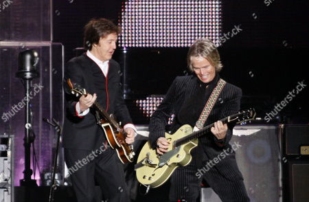 British Musician Former Member of the Band the Beatles Paul Mc Cartney (l) Performs on Stage Next to Us Guitarist Rusty Anderson (r) During His Concert at the River Plate Stadium in Buenos Aires Argentina 10 November 2010 Argentina Buenos Aires