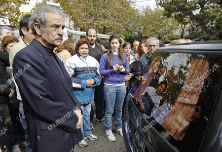 Mario Sabato (l) Son of Argentine Author Ernesto Sabato Stands Next to the Funeral Car During His Father's Wake Held at the Local Club where Sabato Used to Play Dominos Located in the Outskirts of Buenos Aires Argentina 01 May 2011 Argentina Buenos Aires