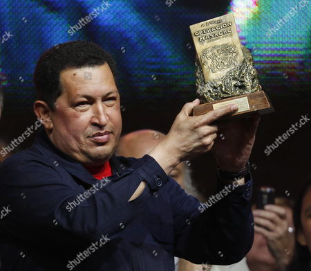 Venezuelan President Hugo Chavez Receives the Rodolfo Walsh Prize From Florencia Saintout (not Pictured) Dean of Journalism of La Plata National University in Buenos Aires Argentina 29 March 2011 Chavez is Visiting Argentina and Met with His Argentinian Counterpart Cristina Fernandez Argentina Buenos Aires