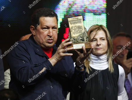 Venezuelan President Hugo Chavez (l) Receives the Rodolfo Walsh Prize From Florencia Saintout (r) Dean of Journalism of La Plata National University in Buenos Aires Argentina 29 March 2011 Chavez is Visiting Argentina and Met with His Argentinian Counterpart Cristina Fernandez Argentina Buenos Aires