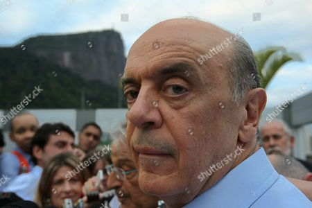 Stock Photo of Brazilian Opposition Presidential Candidate Jose Serra Gets Prepared to Talk to the Press After a Meeting with Green Party Leader Fernando Gabeira in Rio De Janeiro Brazil 19 October 2010 the President of the Brazilian Social Democratic Party Sergio Guerra Criticized a Survey That Gives the Victory to Ruling Presidential Candidate Dilma Rousseff in the Second Leg Brazil Rio De Janeiro
