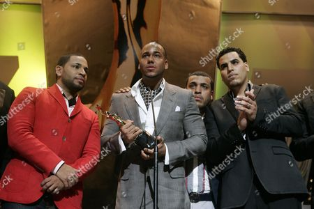 Members of the Bachata Band Grupo Aventura: Anthony Romeo Santos (c) Lenny Santos (r) Max (mikey) Santos (l) Y Henry Santos Jeter (2-r) Pose on Stage After Receiving the Sovereign Award During the Awarding Ceremony of the Xxvi Edition of the Casandra Awards in Saint Domai Dominican Republic 16 March 2010 Dominican Republic Saint Domain