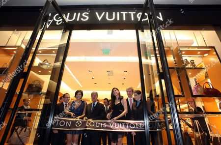 President of the French Luxury Brand Louis Vuitton Yves Carcelle (c) Cuts the Ribbon During the Opening of a Store in a Shopping Center in Santo Domingo Dominican Republic 09 July 2010 the Store is the First One to Be Inaugurated in the Country where the Brand Will Help Mothers and Children with Limited Economic Resources Carcelle Said in a Press Conference That with This New Shop Louis Vuitton Reached a Total of 452 Stores Around the World Dominican Republic Santo Domingo