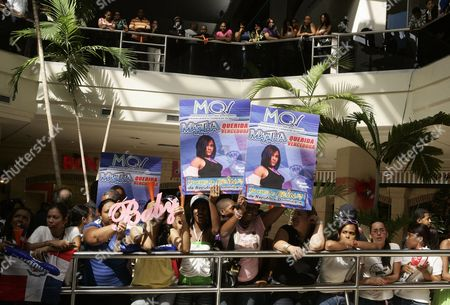 Supporters of Dominican Singer Martha Heredia (unseen) Winner of the Latin American Idol 2009 Contest in Buenos Aires Argentina Wait For Her at the Las Americas International Airport in Santo Domingo Dominican Republic 14 December 2009 Dominican Republic Santo Domingo