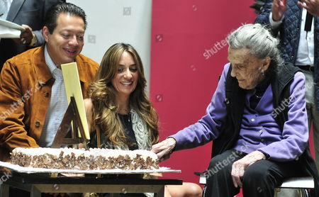 Mexican Painter Born in the United Kingdom Leonora Carrington (r) Cuts a Cake During Her 94th Birthday Meeting at the Centro Cultural Estacion Indianilla in Mexico City Mexico 9 April 2011 where She Has Opened a Exhibition with 10 of Her Sculptures Made Between 2008 and 2010 Mexico Mexico City