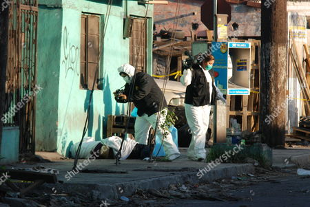 Stock Picture of Forensic Experts Work at the Scene where Edwin Aka 'El Catracho' a 25 Year Old Hondurean Youngster and His Partner 18 Year Old Mexican Yesenia Elizabeth Reyes Were Killed in Monterrey North of Mexico 11 March 2011 Since March 2010 Monterrey Registers a Drug Trafficking War Among Drug Cartels of the Gulf Against Zetas a Group That Extorts and Recruits Central Americans Mexico Monterrey