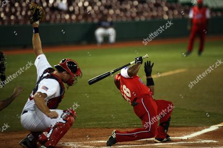 The Cuban Player Alex Bell (r) Dodges the Ball on His Turn at Bat During the Pre World Baseball Game Played Against the United States Team at the Francisco Montaner Stadium in Ponce Puerto Rico on 11 October 2010 Puerto Rico Ponce