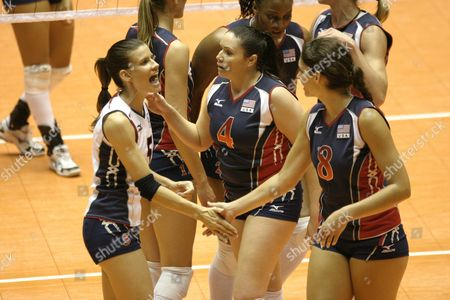 Us Voleyball Players Stacy Sykora (l) Lindsey Berg (c) and Cynthia Barboza (r) Celebrate After Winning a Point Against Dominican Republic During Their Norceca (north America Central America and Caribbean) Voleyball Tournament Match in Bayamon Puerto Rico on 26 September 2009 Puerto Rico Bayamon