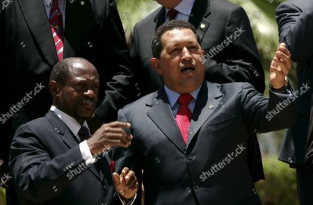 Stock Picture of Venezuelan President Hugo Chavez (r) Talks with the Prime Minister of Saint Kitts and Nevis Denzil Douglas (l) During the 6th Summit of Petrocaribe Held in Basseterre Capital of Saint Kitts and Nevis 12 June 2009 Petrocaribe's Country Members Are Antigua and Barbuda Bahamas Belize Cuba Dominica Granada Guatemala Guyana Haiti Honduras Jamaica Nicaragua Dominican Republic Saint Kitts and Nevis Saint Vicent and the Grenadines Saint Lucia Surinam and Venezuela Saint Kitts and Nevis Basseterre