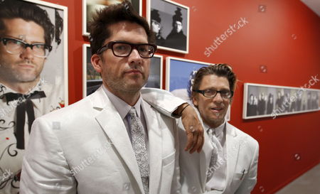 Stock Picture of New York Artists Chistopher Makos (r) and Paul Solberg (l) Also Known As the Hilton Brothers Present Their New Exhibition in Madrid Spain 09 July 2009 the Exhibition 'Mistaken Identity' Has Many Representations of Daily Life and Runs From 10 July to 30 August Spain Madrid