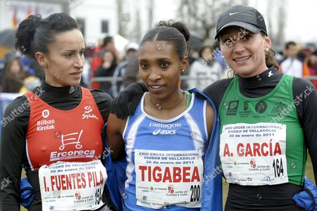 Ethiopian Athlete Marta Tigabea (c) Poses with Spanish Runners Iris Fuentes (l) and Alba Garcia (r) After Competing in the 23th Valladolid International Cross Race on 30 January 2011 in Valladolid Central Spain Tigabea Won the Race Ahead of Fuentes who Finished in Second Position and Garcia who Placed Third Spain Valladolid