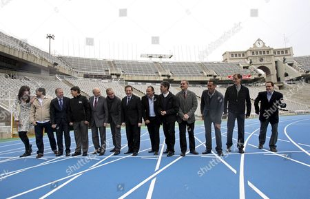 (l-r) Triple-jumper Carlota Castrejano Pole Vault Jumper Javier Garcia Chico; General Director of Mondo Iberica Santiago Palomeroa; President of Spanish Athletics Federation Jose Ma Odriozola; President of European Athletic Association Hansjoreg Wirz; Barcelona Sports Delegate Pere Alcober; City Mayor Jordi Hereu; 1992 Olympic 1500 Meters Winner Fermin Cacho; Olympic Marathonist Martin Fiz; Jordi Mundo Representative of Barcelona Autonomous Community; Barcelona 2010 Ambassadors Jose Manuel Abascal Abel Anton and Valenti Massana Are Pictured During the Presentation of the New Montjuic Olympic Stadium Track in Barcelona Northern Spain on 16 April 2010 a New Synthetic Track Considered to Be the Fastest in the World was Opened on 16 April 2010 at Lluis Companys Montjuic Stadium where the European Athletics Championships 2010 Will Be Held From 27 July to 01 August 2010 Spain Barcelona