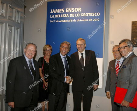 Belgian Acting Prime Minister Yves Leterme (c-r) Salutes Spanish Secretary of State For European Affairs Diego Lopez Garrido (c-l) During His Visit to the Exhibition 'James Ensor the Beauty of Grotesque' in the Carlos De Amberes Foundation in Madrid Central Spain on 30 September 2010 Spain Madrid