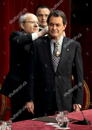 Outgoing Catalonian President Jose Montilla (l) From the Catalonian Socialist Party Gives Elected President Artur Mas (r) From Convergencia i Unio (ciu) the Medal That Accredits Him As the New Regional President at the Palau De La Generalitat in Barcelona Catalonia Northeastern Spain 27 December 2010 Artur Mas Has Promised 'Full Loyalty to Catalonian People' Spain Barcelona